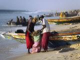 Mauritania, Nouakchott Fishermen Unload Gear from Boats Returning to Shore at Plage Des Pecheurs Fotografisk tryk af Andrew Watson