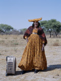 Smartly Dressed Herero Woman Waits for a Bus, Namibia Photographic Print by Nigel Pavitt
