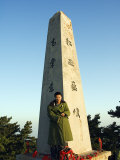 Man in Green Army Jacket on Monument on Top of Mount Hua, China Photographic Print by Christian Kober