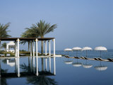 Reflections in the Still Water of the Infinity Pool at the Chedi Hotel Photographic Print by John Warburton-lee