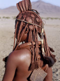Himba Woman in Traditional Attire, Her Body Gleams from a Red Ochre Mixture of Red Ochre, Namibia Photographic Print by Nigel Pavitt