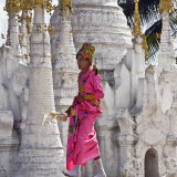 Myanmar, Burma, Lake Inle, A Young Novitiate Passes an Ornate Buddhist Shrine Photographic Print by Nigel Pavitt