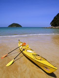 South Island, Nelson, Kayak on Onetahuti Beach in Abel Tasman National Park, New Zealand Photographic Print by Christian Kober