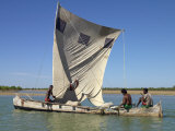 Pirogue or Local Fishing Boat at Morondava, Madagascar Photographic Print by Nigel Pavitt