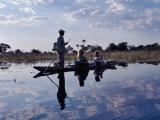 Mekoro being poled thorough Okavango Delta, Botswana, Photographic Print