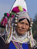 Burma, Kengtung, A Mong La Akha Woman Wearing a Traditional Headdress of Silver and Beads, Myanmar Photographic Print by Nigel Pavitt