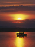 Lower Zambesi National Park, Guests Watching the Sun Rise over Zambezi River from a Boat, Zambia Photographic Print by John Warburton-lee