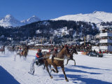 Trotting Race with Jockeys Driving Horse-Drawn Sleighs on the Frozen Lake at St Moritz Photographic Print by John Warburton-lee