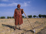Uzbek Man with Hoe in a Field Photographic Print by Antonia Tozer