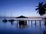 Seychelles, Praslin Island, Anse Bois De Rose, Pier at the Coco De Mer Hotel, Sunset Photographic Print by Walter Bibikow