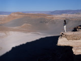 Tourist Looks Out over the Atacama Desert from Las Cornicas Ridge Photographic Print by John Warburton-lee