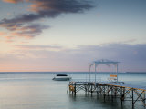 Western Mauritius, Le Morne Peninsula, Pier at the Dinarobin Hotel, Dusk, Mauritius Photographic Print by Walter Bibikow