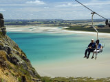 Tasmania, Stanley, Sawyer Bay, Visitors on Chair Lift Going to the Nut at Circular Head, Australia Photographic Print by Christian Kober