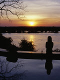 Livingstone, the River Club, Sundowners at the Pool Looking Out over the Zambezi River, Zambia Photographic Print by John Warburton-lee