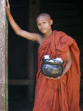 Novice Monk with Food Bowl and Utensils at Pathain Monastery, Sittwe, Burma, Myanmar Photographic Print by Nigel Pavitt