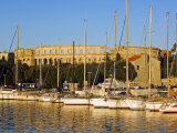 Late Afternoon Light on Yachts in Harbour with the Roman Amphitheatre in the Background Photographic Print by Christian Kober