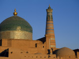 Minaret and Tiled Dome of a Mosque Rise Above the Old City of Khiva Photographic Print by Antonia Tozer