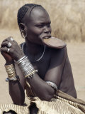 Mursi Woman Wearing a Large Clay Lip Plate, Omo Delta, Ethiopia Photographic Print by Nigel Pavitt