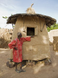 Mopti, A Bobo Man Beside His Millet Granary at a Bobo Village Near Mopti, Mali Photographic Print by Nigel Pavitt