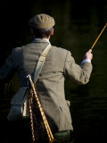 Trout Fisherman Casting to a Fish on the River Dee, Wrexham, Wales Photographic Print by John Warburton-lee