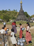 Against a Backdrop of Ancient Temples, Rakhine Women Draw Water from a Well at Mrauk U, Myanmar Photographic Print by Nigel Pavitt