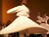 Fes, Two Whirling Dervishes Perform During a Concert at Fes Festival of World Sacred Music, Morocco Photographic Print by Susanna Wyatt