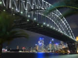 New South Wales, Sydney, Palm Trees Frame the Sydney Harbour Bridge and Skyline of Central Sydney,  Photographic Print by Andrew Watson