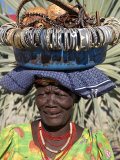 Himba Street Vendor at Opuwo Who Sells Himba Jewellery, Arts and Crafts to Passing Tourists Photographic Print by Nigel Pavitt