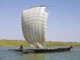 Niger Inland Delta, A Pirogue under Sail on the Niger River Between Mopti and Timbuktu, Mali Photographic Print by Nigel Pavitt