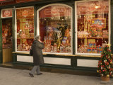 Woman Looking at Chocolate Shop Selling Mozart Chocolates and Other Christmas Sweets Photographic Print by Richard Nebesky