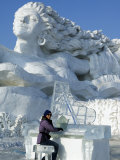 Harbin City, A Tourist Is Playing a Sculpted Ice Piano, Snow and Ice Festival, China Photographic Print by Christian Kober