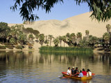 Family Rows Out onto the Oasis Lagoon of Huacachina, Near Ica in Southern Peru Photographic Print by Andrew Watson