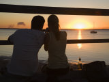 Queensland, Fraser Island, A Couple with Video Camera in Hand Watch Sunset from a Pier, Australia Photographic Print by Andrew Watson
