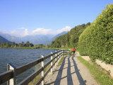 Man Bikes Along Path at Lake's Edge, Lake Como, Italian Lakes, Lombardy, Italy, Europe Photographic Print by Vincenzo Lombardo