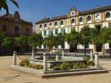 Plaza Del Triunfo in the Real Alcazar Palace in Seville, Spain Photographic Print by John Warburton-lee