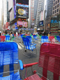 Garden Chairs in the Road for the Public to Sit in the Pedestrian Zone of Times Square, Manhattan Photographic Print by Amanda Hall