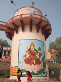 Mural of Lakshmi, Goddess of Wealth, on a Water Tower, Dasaswamedh Ghat, Varanasi, Uttar Pradesh Photographic Print by Wendy Connett
