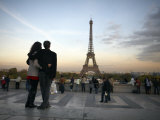 Couple Look Towards the Eiffel Tower, Paris, France, Europe Photographic Print by Andrew Mcconnell