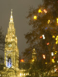 Tree Decorated with Lit Christmas Presents and Rathaus Tower at Rathausplatz at Twilight Photographic Print by Richard Nebesky