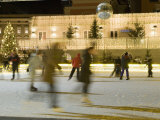 Ice Skating at Night on Ice Rink at Mozartplatz Square, Salzburg, Austria, Europe Photographic Print by Richard Nebesky