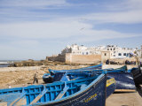 Small Wooden Fishing Boats on Seafront with White Buildings of the Medina Beyond, Essaouira Photographic Print by Pearl Bucknall