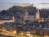 Snow Covered Old Town Dominated by the Fortress of Festung Hohensalzburg at Twilight Photographic Print by Richard Nebesky