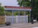 Station Sign at Llanfairpwllgwyngyllgo-Gerychwyrndrobwllllantysiliogogogoch Photographic Print by Nigel Blythe