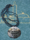 Pendant Inscribed with Peace in Arabic and French, Lyon, Rhone, France, Europe Photographic Print by Godong 