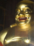 Large Golden Smiling Buddha in Kek Lok Si Buddhist Temple, Air Itam, Georgetown, Penang Photographie par Annie Owen
