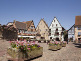 Flower Tubs in Place Du Chateau Square in Medieval Village on the Wine Route, Eguisheim Photographic Print by Pearl Bucknall