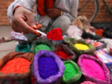 Dye Trader Offers His Brightly Coloured Wares in a Roadside Stall in Kathmandu, Nepal, Asia Photographic Print by David Pickford