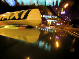 Close Up of Taxi Sign on Car Roof with Neon Road Signs, Shanghai, China, Asia Photographic Print by  Purcell-Holmes