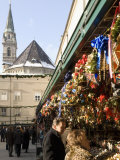 Stall Selling Christmas Decorations with Towers of Franziskanerkirche Churchbehind Photographic Print by Richard Nebesky