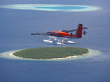 Maldivian Air Taxi Flying Above Island, Maldives, Indian Ocean, Asia Photographic Print by Sakis Papadopoulos